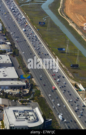 Traffic on Bayshore Freeway ( U.S. Route 101), San Carlos, San Francisco, California, USA - aerial - Stock Photo