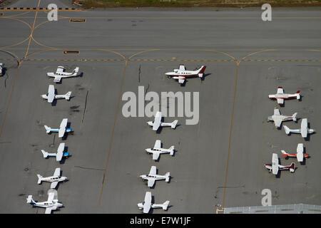 Light planes parked at San Carlos Airport, San Francisco, California, USA - aerial - Stock Photo