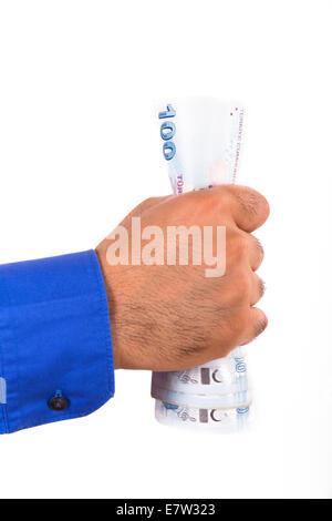Hand squeezing one hundred Turkish lira banknotes, isolated on white background. - Stock Photo
