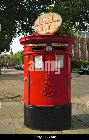 A red British pillar box with two apertures, one for stamped, one for franked, mail, London, England. From reign - Stock Photo