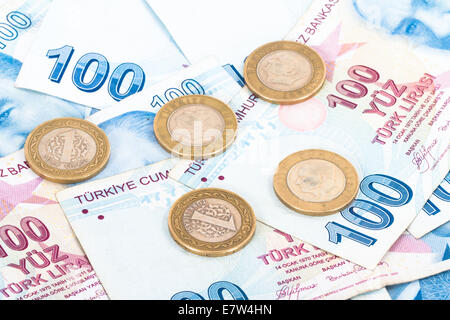 Close up view of one hundred Turkish lira banknotes with coins. - Stock Photo