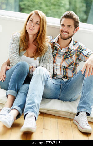 Couple relaxing indoors - Stock Photo