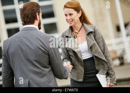 Two business people greeting each other - Stock Photo