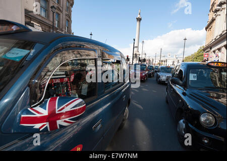 London, UK. 24th Sep, 2014. Several hundred Black Cabs clog Whitehall as they stage a 'go slow' protest. The demo - Stock Photo