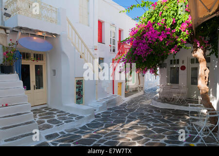 Pretty whitewashed street in the old town of Mykonos, Greece - Stock Photo