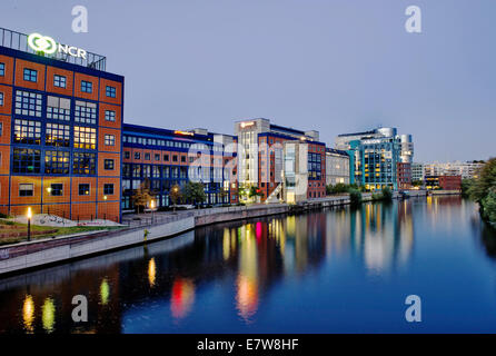 Light plays of the buildings of the Spreebogen in Moabit upon the water of the river Spree in Berlin, Germany. The - Stock Photo