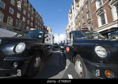 London, London, UK. 24th Sep, 2014. Several hundred Black Cabs clog Whitehall as they stage a ''˜go slow' protest. - Stock Photo