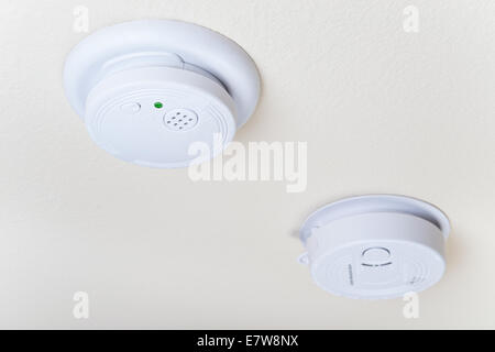Smoke fire and a carbon monoxide alarm mounted on the ceiling - Stock Photo