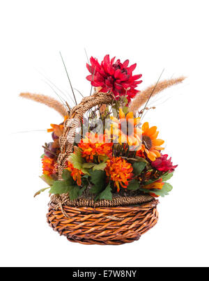 Autumn flower arrangement in a basket isolated on white - Stock Photo