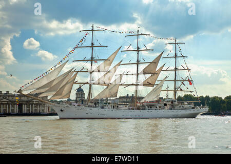 The Dar Mlodziezy tall ship, passing The Old Royal Naval College at Greenwich. - Stock Photo