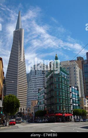 Transamerica Pyramid skyscraper and copper green Columbus Tower (aka Sentinel Building) downtown San Francisco, - Stock Photo
