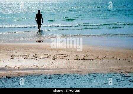 The word Florida written in the sand at Siesta Beach Sarasota Florida - Stock Photo