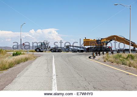 Heavy hauling Caterpillar 390D Excavator oversize load Arizona multi axle trailer - Stock Photo