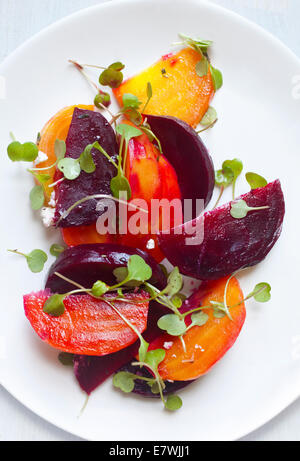 Yellow, orange, and red beet salad - Stock Photo