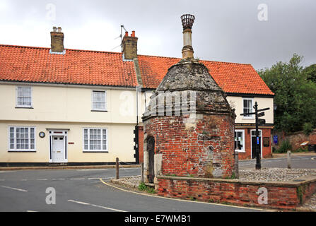 A view of the old Pump house in Common Place, Little Walsingham, Norfolk, England, United Kingdom. - Stock Photo