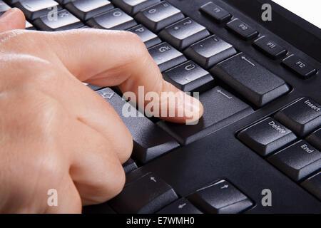 Index finger pressing enter key, button on keyboard. - Stock Photo