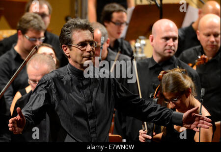 Prague, Czech Republic. 24th Sep, 2014. British conductor Nic Raine is seen during the opening of the Film Music - Stock Photo