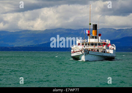 Paddle steamer Simplon on Lake Geneva or Lac Leman with storm clouds, Yvoire, Rhone-Alpes, Haute-Savoie, France - Stock Photo