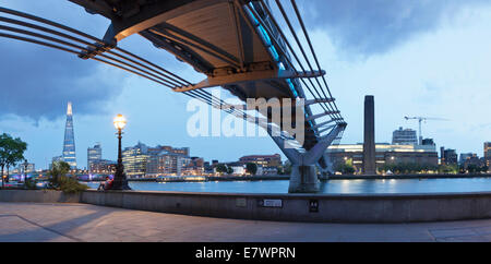 Millennium Bridge from below with views of The Shard skyscraper and Tate Modern, River Thames, London, England, - Stock Photo