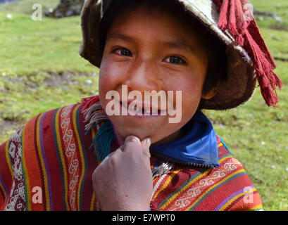 Young boy wearing traditional costume, Andes, near Cusco, Peru - Stock Photo