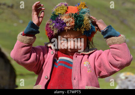 Girl wearing traditional costume, Andes, near Cusco, Peru - Stock Photo