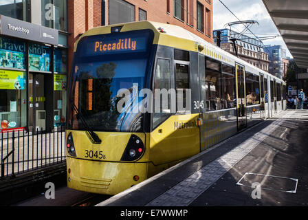 Manchester Metrolink  Transport Links commuters & public transport, Manchester Piccadilly Gardens Tram Station, - Stock Photo