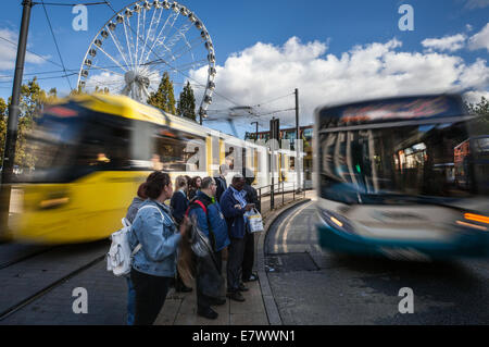 Manchester Metrolink Trams & Piccadilly Gardens Bus station. Traffic, passengfers & Transport Links, Manchester - Stock Photo