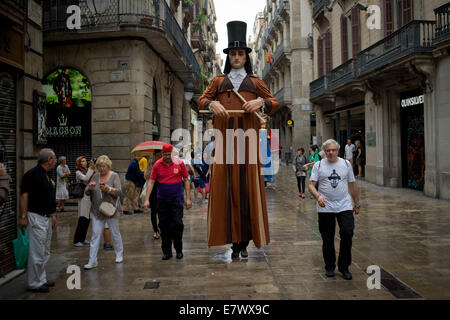 Barcelona, Catalonia, Spain. 24th Sep, 2014. L'Hereu, traditional  Catalan giant,  through the streets of Barcelona. On 24 September, the city of Barcelona celebrates the day of its patron saint (La Mercè) with several festive , traditional and religious events. Credit:   Jordi Boixareu/Alamy Live News