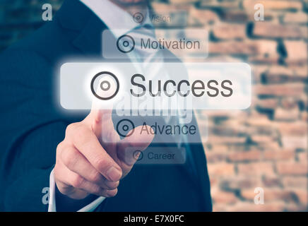 Businessman pressing a Success concept button. Instagram Styling Applied. - Stock Photo