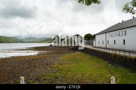 Talisker Distillery on the shore of Loch Harport on the Isle of Skye, Scotland.