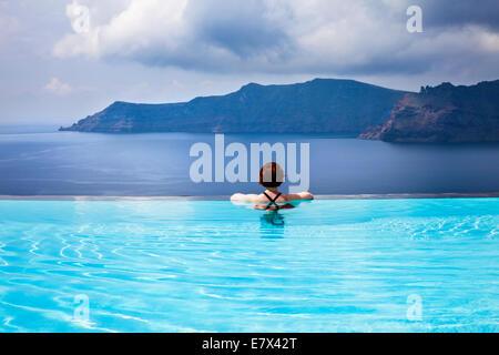 Seascape with the infinity pool, Oia, Santorini (Thira), Greece - Stock Photo