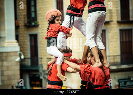 Barcelona, Spain. 24th Sep, 2014. The 'Castellers de Barcelona' build a human tower during the city festival 'La Merce 2014' in front of the town hall of Barcelona Credit:  matthi/Alamy Live News