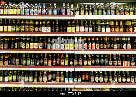 English bottled beers for sale in a supermarket on shelves, Tesco, Newmarket, UK - Stock Photo