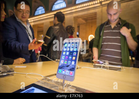 An iPhone 6 Plus on display in the Apple store in Grand Central Terminal in New York - Stock Photo