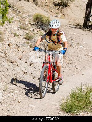 Stock Photo - Middle school aged children 10 - 14 mountain biking on ...