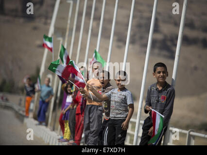 Tehran, Iran. 25th Sep, 2014. September 25, 2014 - Tehran, Iran - Iranian boys rise Iran flags as they watch 2014 - Stock Photo