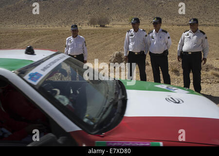 Tehran, Iran. 25th Sep, 2014. September 25, 2014 - Tehran, Iran - Iranian traffic police officers stand behind a - Stock Photo