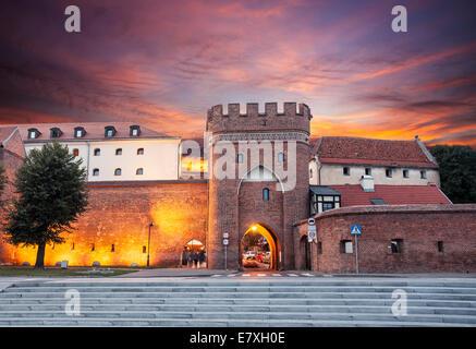 Sunset over old town of Torun, Poland. - Stock Photo