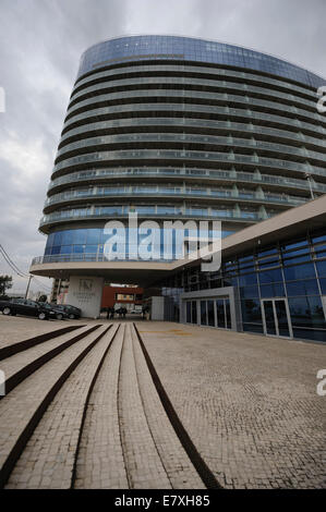 Building with modern architecture and curved glass balconies - Stock Photo