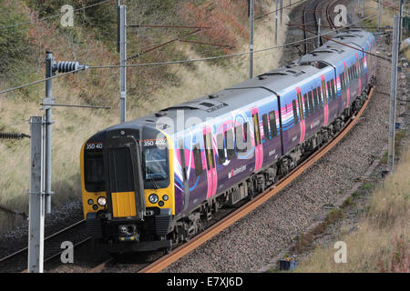 Glasgow to Manchester Airport electric multiple unit train seen on the West Coast Main Line near Lowgill on 24th - Stock Photo