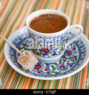 Turkish coffee with turkish delight in ornamental cup and saucer - Stock Photo