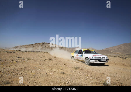 Tehran, Southern Iran. 25th Sep, 2014. Iranian driver Farzad shahrokhi competes during the first stage of the Middle - Stock Photo