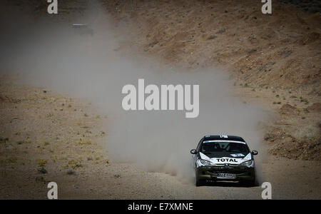 Tehran, Southern Iran. 25th Sep, 2014. Iranian driver Misagh Ghasemi competes during the first stage of the Middle - Stock Photo