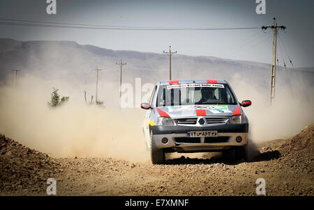 Tehran, Southern Iran. 25th Sep, 2014. Iranian driver Nader Javaherian competes during the first stage of the Middle - Stock Photo