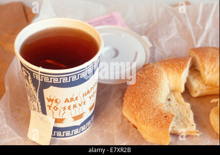 Tea Steeping in Paper Street Vendor Cup with Fresh Bagel, NYC, USA - Stock Photo