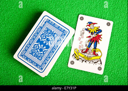 Joker and deck of cards - Stock Photo