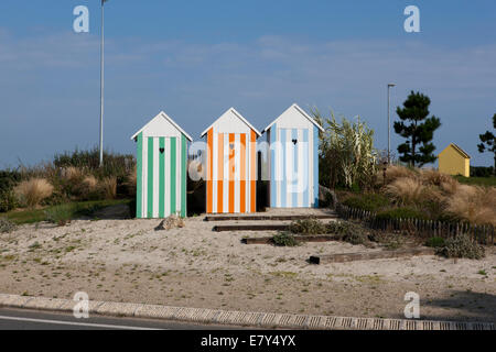 Beach Huts on a traffic roundabout in France near the town of Roscoff. - Stock Photo