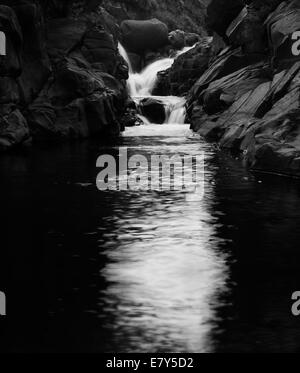 Black and white river waterfall at Lotheni, KwaZulu-Natal in the South African Drakensburg mountains - Stock Photo