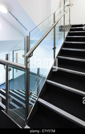 Modern staircase witt stainless steel hand rails.