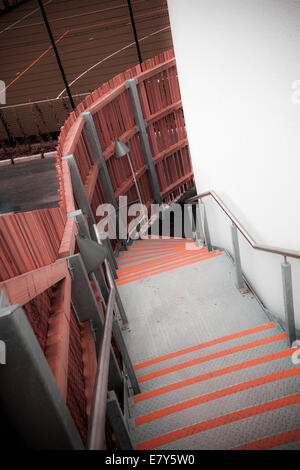 Looking down exterior fire escape on modern building. - Stock Photo